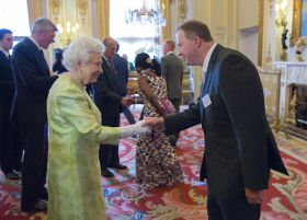 Queen congratulates Blue Skies staff at award reception