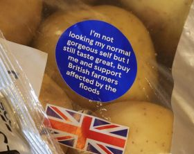 Tesco use stickers to highlight flood impact