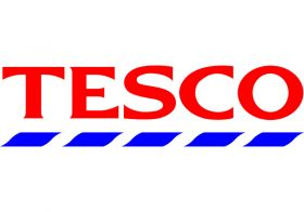 Tesco profits take half-year tumble