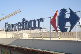Carrefour profit hit by downturn