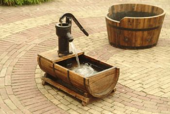 Wooden half barrel fountain